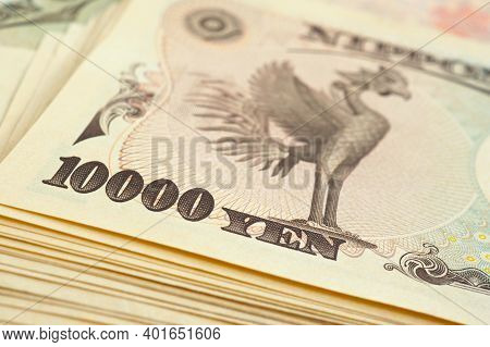 A Bundle Of 10000 Yen Japanese Bills. The Reverse Of The Banknote With The Image Of The Phoenix Bird