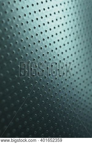 Dark Vertical Industrial Wallpaper. Tinted Blue-green Metal Background. Perforated Aluminum Surface