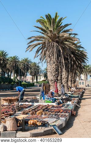 Swakopmund, Namibia - June 18, 2012: A Street Scene In Swakopmund, With Vendors Displaying Their Goo