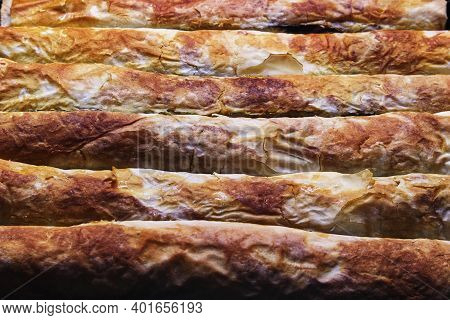 Details Of Apple Pie From Serbia, Closeup View On Kitchen Desk.
