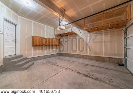Residential Garage Interior Under Construction With Unfinished Wall And Floor