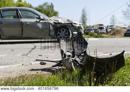 Car Crash Accident On The Road, Damaged Car After Collision Is Deployed Against Traffic. Front Of Ca