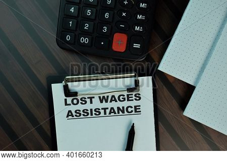 Lost Wages Assistance Write On A Paperwork Isolated On Wooden Table. Business Or Finance Concept