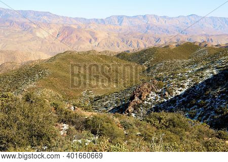 High Desert Mountain Ridge Covered With Chaparral Plants Surrounded By A Dusting Of Snow Taken In Th