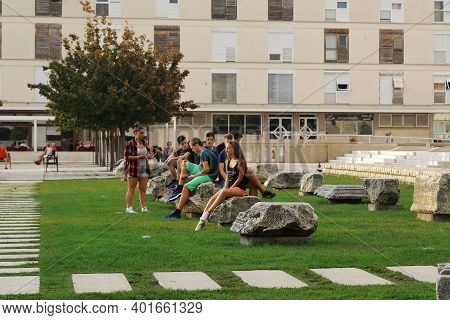 Zadar, Croatia - September 14, 2016: Unidentified Young People Have Gathered And Are Sitting On The