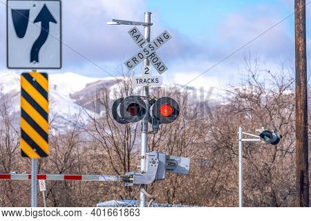Grade Crossing Signal With Red Light Gate And Crossbuck At Railroad Crossing