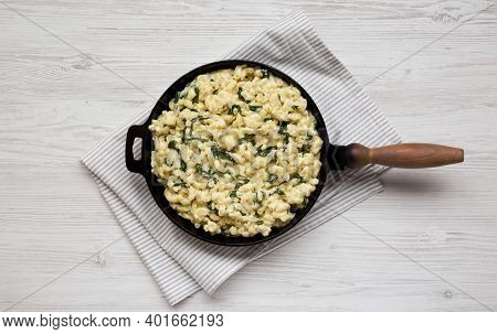 Homemade Spinach Mac And Cheese In A Cast-iron Pan On A White Wooden Background, Top View. Flat Lay,