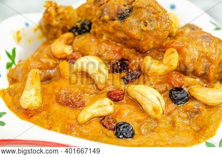 Closeup Of A Very Tasty Chicken Curry Added With Cashew Nuts And Raisins