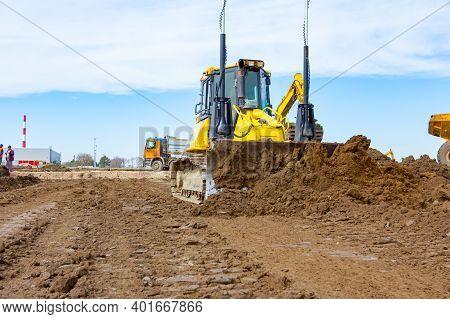 Bulldozer Is Pushing Ground, Leveling, Equates Building Site.