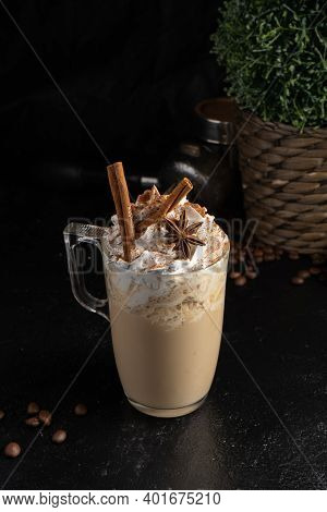 Cocoa With Whipped Cream, Cinnamon Sticks And Star Anise In A Transparent Mug. A Hot Drink Made Of C