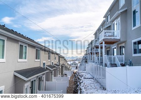 Back View Of Townhouses On A Scenic Suburban Neighborhood On A Snowy Winter Day