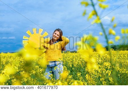 Young Woman Enjoying Nature And Sunlight Yellow Sun Hand Made In The Hands Of A Teenage Girl. The Co