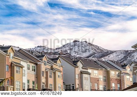 Snowy Wasatch Mountain Viewed From A Residential Neighborhood With Townhouses