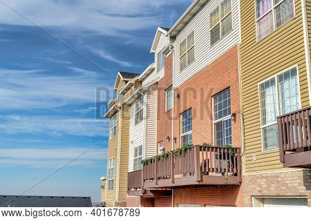Townhouses With Balconies That Looks Out To Scenic Views Of The Neighborhood