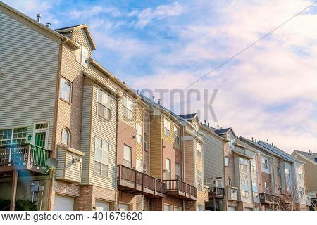Residential Landscape On A Sunny Day Setting With Exterior View Of Townhouses