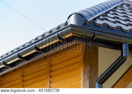 Corner Of The New Modern House With Roof And Gutter And Wooden Shutter