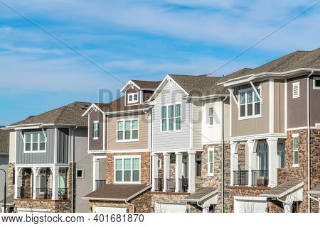 Townhouses In Utah Valley With Balconies Garages And Stone Brick And Wood Walls