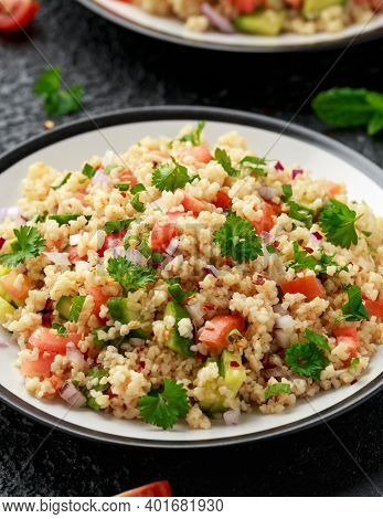 Tabbouleh Salad With Tomato, Cucumber, Red Onion, Bulgur And Parsley. Healthy Vegan Food