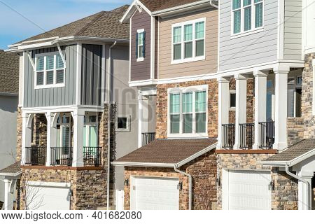 Townhouses With Balconies And Garages At The Facade On A Sunny Day Landscape