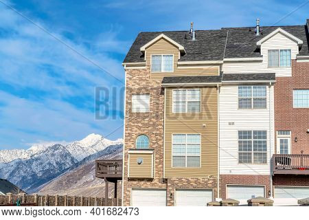 Stunning Wasatch Mountains And Snowy Peak With Townhouse In The Foreground