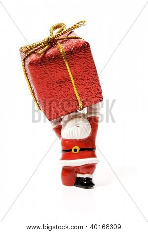 Santa Claus holding a huge gift isolated on white background.