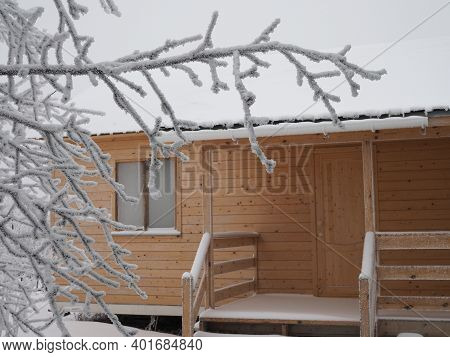 A Small Suburban House In Winter On Cloudy Day