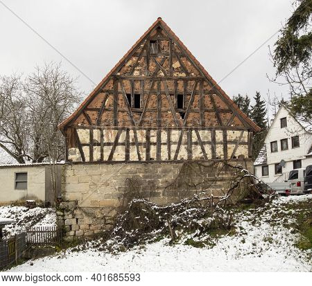 Old Half-timbered Facade Of A Barn At Winter Time