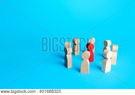 Red Figurine Of A Man Surrounded By People. Leader And Significant Person, Important. Uniting Around