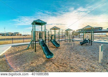Childrens Playground At Neighborhood Park In Utah Valley Against Cloudy Blue Sky