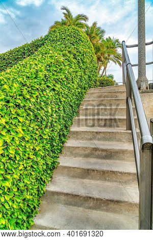 Concrete Stairs Going Up A Footbridge Over A Canal In Long Beach California