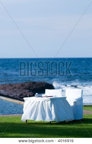 White Table And Chairs By The Seaside