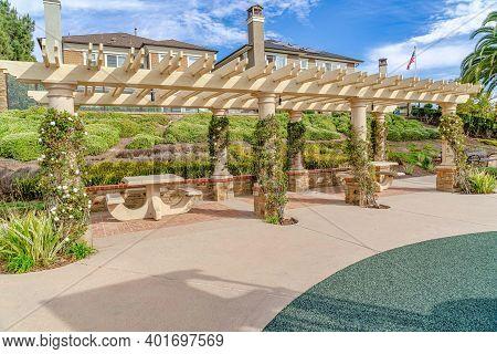 Pergola With Vines And Sitting Areas In Huntington Beach California Neighborhood