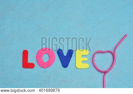 The Word Love With A Heart Shape Pink Straw