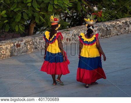 Afrocolombian Women Fruit Vendor Seller In Colombian Colored Dress Skirt Costume Walking In Cartagen