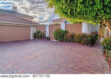 Garage And Driveway Inside Fence And Gate Of Huntington Beach California Home