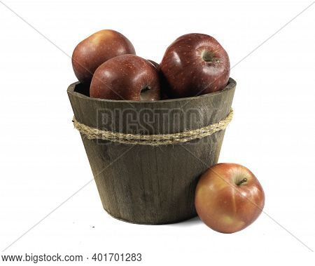 Red Ripe Apples In Wooden Bucket Isolated On White