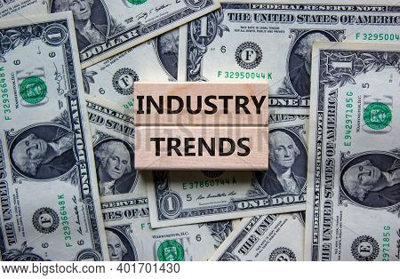 Industry Trends Symbol. Wooden Blocks With Words 'industry Trends' On Beautiful Background From Doll