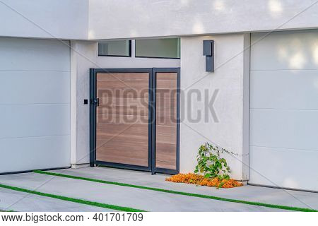 Gate And Driveway With Grasses At Home Exterior In Huntington Beach California