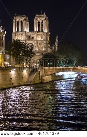 Paris, France - 09-10-2018: The Cathedral Of Notre Dame And The River Seine Illuminated At Night