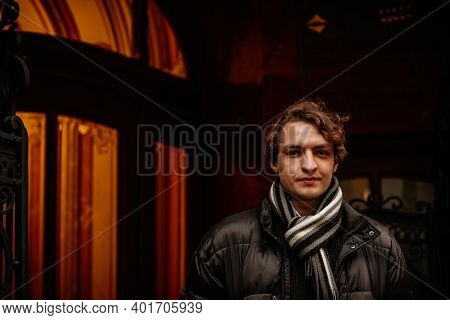 Handsome Stylish Young Hipster Man Wearing Winter Clothes In Street. Portrait Of Beautiful Guy With