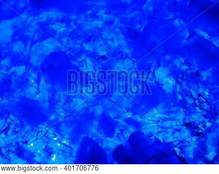 Macrophotography Of Blue Transparent Crystals Of Copper Sulfate. Crystal Surface Texture.