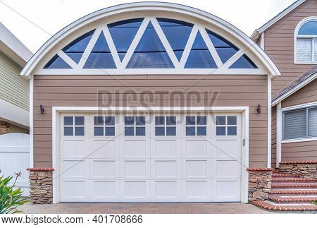 Garage Of Home In San Diego California With Arched Roof And Glass Paned Door