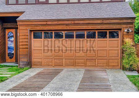 Glass Paned Brown Front Door And Garage Door Of House In San Diego California