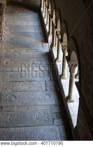 Girona Cathedral Spain. The Historic Medieval Cloisters Of The Ancient Cathedral. Sunlight Shines Th