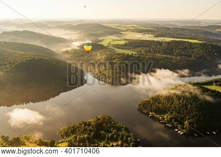 Hot Air Balloon Floating In The Morning Light Over Slapy Dam