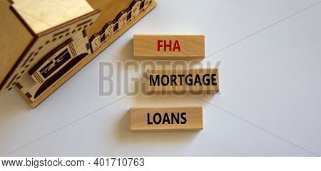 Fha Mortgage Loans Symbol. Wooden Blocks With Words 'fha Mortgage Loans' Near Miniature House. Beaut