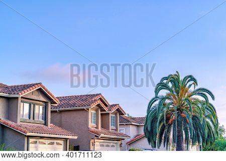 Houses In San Diego California Neighborhood Against Blue Sky On A Sunny Day