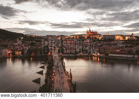 Charles Bridge Over The Vltava River In Prague. Prague Castle In The Background.