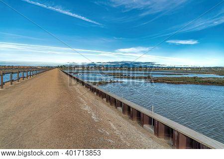 Footbridge And Scenic Wetlands In Bolsa Chica Nature Reserve Huntington Beach Ca