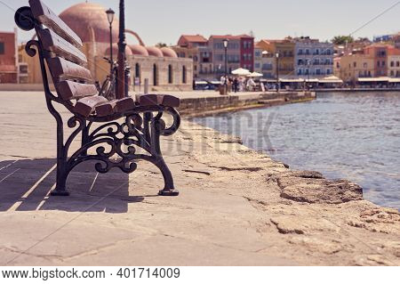 Bench On The Embankment In Chania, Crete. Copy Space.